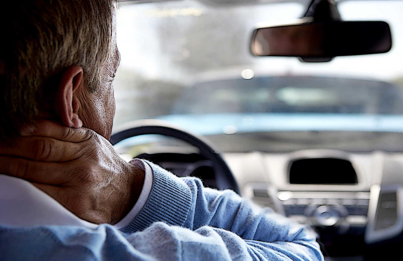 Guy-Holding-Neck-in-Car-1700x1100